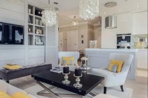 salon (5).jpgaSalon zaprojektowany przez studio projektowe D-Zone, budzi same najlepsze skojarzenia. Jest tu miejsce na nutę elegancji, rys ekstrawagancji i dużo domowego ciepła. Urządzony w kojącej, beżowej tonacji, wydaje się idealnym miejscem do odpoczynku bądź spotkania z przyjaciółmi. Kolor żółty wnosi ciepło, a dodatki intrygują, wpisując się idealnie w całość.