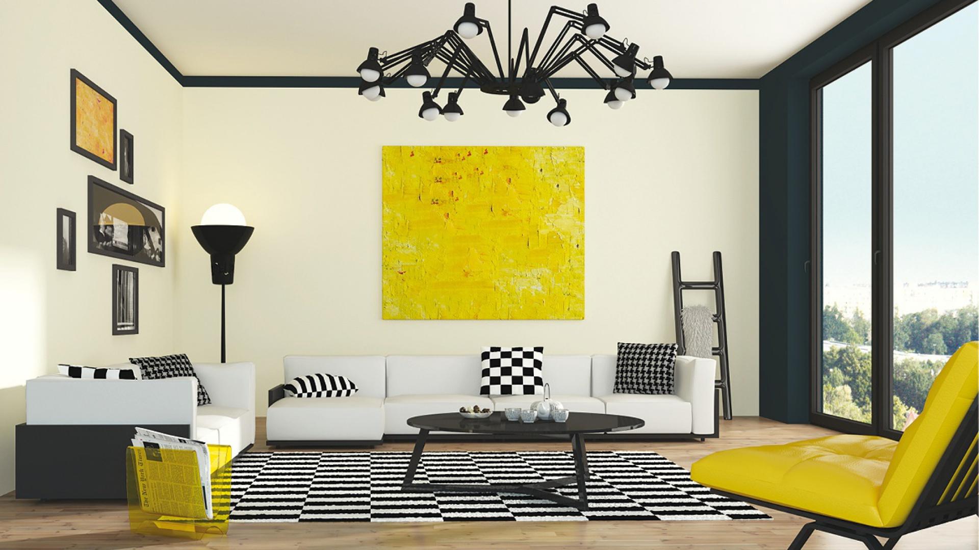Modna propozycja marki Śnieżka - jasne kremowe ściany zestawione z ciemnym grafitem i ożywione mocną żółcią. Fot. Śnieżka.