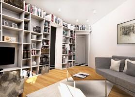 Głównym elementem aranżacyjnym tego pomieszczenia jest zabudowa o nieregularnym kształcie na książki biegnąca po całej ścianie.