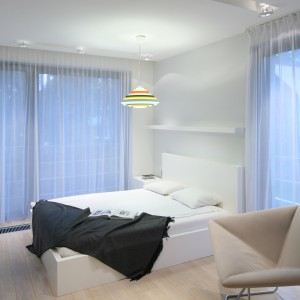 Nad łóżkiem umieszczono dodatkową, białą półkę. Proj. Nasciturus design. Fot. Bartosz Jarosz.