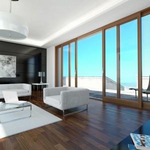 Otwarte wnętrza dzięki panoramicznym oknom są bardzo dobrze oświetlone. Energooszczędne okna nie powodują strat ciepła. Fot. Sokółka Okna i Drzwi S.A.
