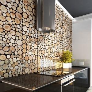 Ścianę w kuchni można wykończyć również panelami. Tutaj mamy przykład paneli o niezwykle oryginalnej, niebanalnej fakturze. Wykonane z naturalnego drewna, trójwymiarowe panele tworzą na ścianie efekt niewielkich drewnianych pieńków. Fot. Stegu, panele Pure Wood Collection.