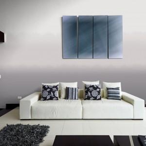 Jasny, czysty a przy tym elegancki salon otula przyjemna dla oka szarość ścian, czynią minimalistyczne wnętrze bardziej przytulnym. Fot. Śnieżka.