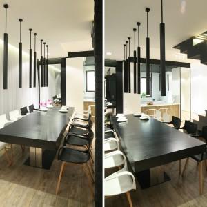 Niewielką powierzchnię kuchni rekompensuje jadalnia zimponującym stołem, przy którym może zasiąść nawet kilkanaście osób. Fot. Bartosz Jarosz.