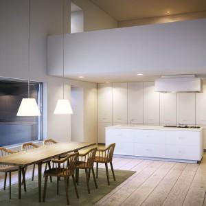 Nowoczesne meble kuchenne o prostych kształtach i minimalistycznym wyrazie zestawiono z jasnobrązowym stołem jadalnianym. Piękną, schludną aranżację dopełniają stylizowane krzesła. Fot. Ballingslov, linia Studio.