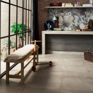 Wielkoformatowe płytki One Cement polecane do aranżacji przestrzeni w stylu loft. Modny efekt cementu nadaje wnętrzu industrialny charakter. Idealne do nowoczesnej kuchni. Fot. Ceramiche Ceasar.