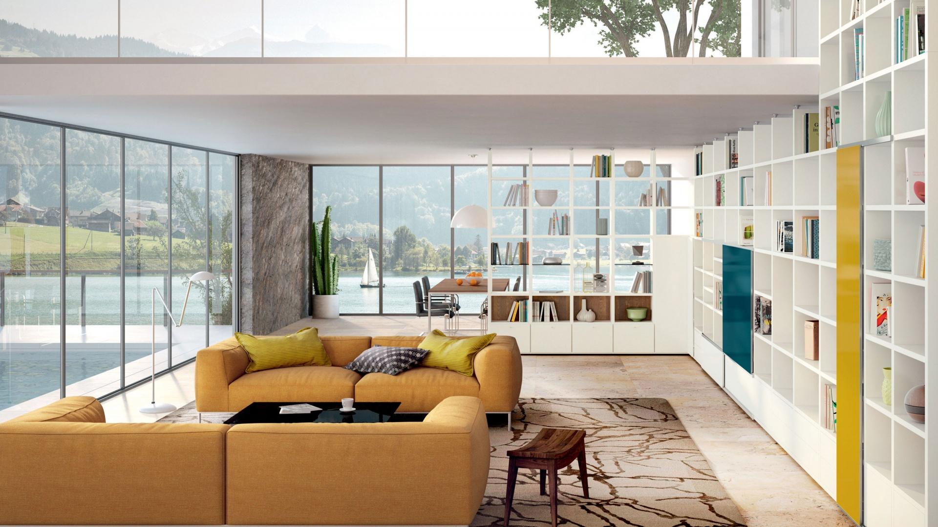 Urządzając domową bibliotekę, największe pole do popisu mamy na etapie projektowania domu.  Wtedy to możemy przeznaczyć na książki najwięcej miejsca i rozplanować ich umieszczenie w najbardziej ergonomiczny sposób. Fot. Hülsta.