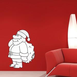 Naklejka ścienna przypominająca Świętego Mikołaja to ciekawa dekoracja salonu, jak również nie lada atrakcja dla dzieci, gdyż mogą go samodzielnie pokolorować kredkami. Fot. In-Spaces.