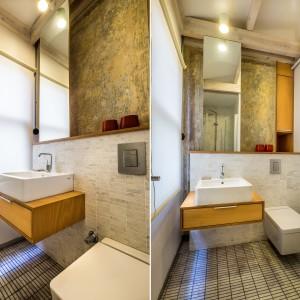 W łazience zabytkowe freski zestawiono z szarymi płytkami. Całość wykończono w nowoczesnym, hotelowym stylu, z ceramiką sanitarną o kubistycznych formach. Projekt: Atelye70. Fot. Emrah Aydemir.