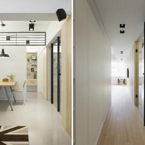 Przestrzeń mieszkania została urządzona tak, aby była elastyczna i przenikająca się. Kuchnię od jadalni oddzielają mobilne ścianki, a strefę dzienną od korytarza, prowadzącego do sypialni odgrodzono szklanymi drzwiami. Projekt: KC Design Studio. Fot. KC Design Studio.