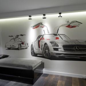 Ścianę w pokoju dziecięcym zdobi mural autorstwa Kuby Wiśniewskiego. Projekt: Marta Pala-Szczerbak. Fot. Piotr Lipiecki.