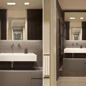 W mniejszej łazience, zlokalizowanej niedaleko wejścia do mieszkania, panują nieco ciemniejsze barwy. Zamknięte w geometryczne, ostre formy nadają pomieszczeniu męski, surowy charakter. Projekt: Coblonal Arquitectura. Fot. Coblonal Arquitectura.