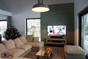 Podstawą industralnego wnętrza jest wygodna sofa modułowa i dobre oświetlenie. Fot. MGM Design