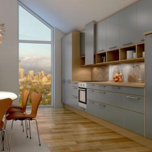 Matowe fronty kuchenne w kolorze szaroniebieskim przełamano blatem i korpusem w kolorze drewna. Satynowe wykończenie i beżowe ramy nadają wnętrzu domowy klimat. Fot. Sigdal, kuchnia Casa.