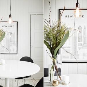 Nad stołem jadalnianym zawisło stylowe oświetlenie. Żarówka w edisonowskim klimacie, swobodnie opuszczona została na wyeksponowanym na tle białych ścian, czarnym kablu. Fot. Stadshem/Jonas Bergman.