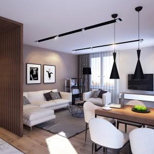 Na tle szarości, brązów i beżów wyeksponowano czarne elementy dekoracyjne. Nowoczesne lampy nad stołem i wnęki w suficie harmonizują z czarnym, efektownym stolikiem kawowym. Projekt: Studio projektowe Geometrium.