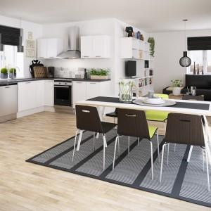 Biel idealnie sprawdza się w małych kuchniach, których nie przytłacza. Aby jednak urozmaicić aranżację, warto wybrać blat w ciemnym kolorze. Fot. HTH, model Erhverv.