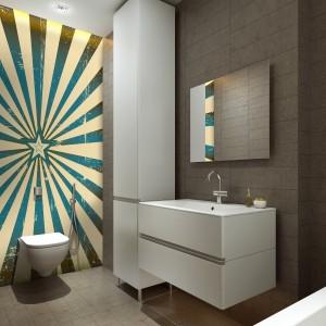 Graficzny wzór umieszczony na ścianie ukrywającej stelaż miski ustępowej wprowadza do wnętrza łazienki nowoczesny charakter. Fot. Minka.