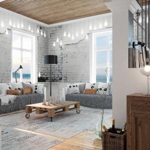 Fototapeta imitująca starą białą cegłę to prosty sposób na szybką metamorfozę salonu. Fot. Livingstyle.