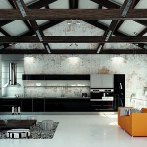Minimalistyczne meble kuchenne z czarnymi frontami na wysoki połysk, urozmaiconymi o szare elementy idealnie wpasowały się w tą loftową aranżację. Tutaj surowe, przetarte ściany oraz wyeksponowane belki konstrukcyjne pod sufitem nadają ton całemu wnętrzu. W charakter wnętrza idealnie wpisują się również loftowe lampy. Fot. HTH, kuchnia Modern Eg Natur.