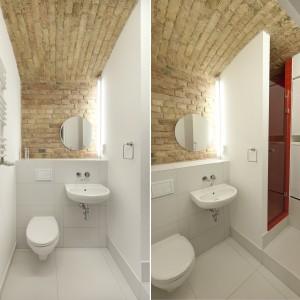 W łazience króluje biel i cegła, pokrywająca sufit i jedną ze ścian. Umywalkę zamontowano w sąsiedztwie wc, a na delikatnym podeście zlokalizowano strefę prysznica. Projekt: Mili Młodzi Ludzie. Fot. PION.