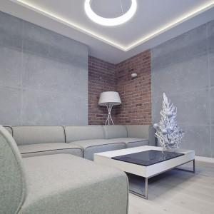 W oszczędnie zaaranżowanej przestrzeni, rolę dekoracji pełni oświetlenie. Pasy ledowe poprowadzone wokół sufitu, stanowią swoistą ramę świetlną, w której centrym znalazł się okrągły żyrandol. Fot. RED Real Estate Development.