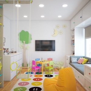 Dla trójki najmłodszych domowników zaplanowaną jasną, kolorową bawialnię, z licznymi atrakcjami. Pomieszczenie znajduje się w sąsiedztwie kuchni i jest na nią otwarte, tak aby dzieci pozostawały pod czujnym okiem mamy. Projekt i wizualizacje: Studio projektowe Geometrium.