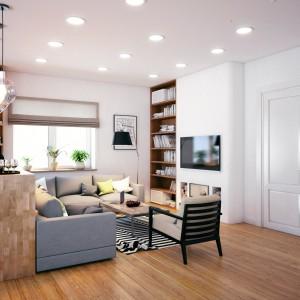 Granicę pomiędzy kuchnią i salonem wyznacza symbolicznie półwysep, pełniący funkcję domowego baru. Usytuowanie względem salonu pozwala zrelaksować się z przyjaciółmi oglądając jednocześnie telewizję w salonie. Projekt i wizualizacje: Studio projektowe Geometrium.