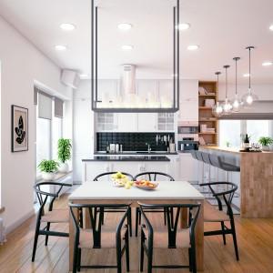 Białe meble kuchenne zwieńczone drewnianym blatem w jasnym kolorze i wtórująca mu drewniana podłoga przywodzą na myśl wnętrza skandynawskie. Projekt i wizualizacje: Studio projektowe Geometrium.