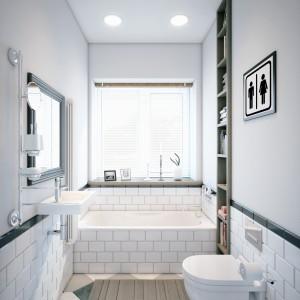 Na parterze urządzono także łazienkę dla gości. Dominuje tutaj biel, a wannę wyłożono płytkami, imitującymi kafle. Projekt i wizualizacje: Studio projektowe Geometrium.