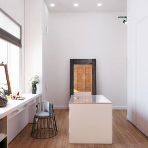 Pod oknem w garderobie wygospodarowano miejsce na funkcjonalną toaletkę. Projekt i wizualizacje: Studio projektowe Geometrium.