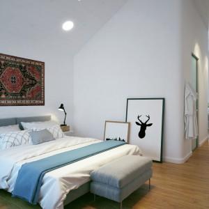 Sypialnia małżeńska rodziców została połączona z garderobą i prywatną łazienką, do której wstęp mają tylko pan i pani domu. Projekt i wizualizacje: Studio projektowe Geometrium.