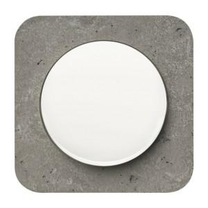 Seria Berker R.1. Ramka z polerowanego betonu. Klawisz z tworzywa w białym połysku. Fot. Hager.
