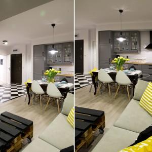 Podłogę w strefie dziennej wykończono dwoma rodzajami posadzki. W sąsiedztwie wejścia do mieszkania i w przestrzeni kuchni jest to mocny akcent w postaci czarno-białej szachownicy. Projekt: SHOKO.design. Fot. Małgorzata Opala.