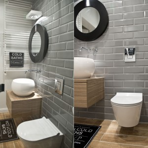 Ściany w łazience wykończono szarymi, glazurowanymi płytkami imitującymi kształtem tradycyjne, stare kafle. Podłogę pokrywają płytki drewnopodobne, harmonizujące z materiałem, którym wykończono szafkę podumywalkową. Elementy w kolorze drewna ocieplają wizualnie przestrzeń, a także sprawiają, że łazienka wydaje się być bardziej ekskluzywna. Projekt: SHOKO.design. Fot. Małgorzata Opala.