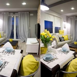 Zamiast tradycyjnego stolika kawowego w salonie znalazła się paleta, zaadaptowana na stolik. Element ten nadaje wnętrzu industrialny charakter. Z kolei miękkie firany budują we wnętrzu przytulny charakter. Projekt: SHOKO.design. Fot. Małgorzata Opala.