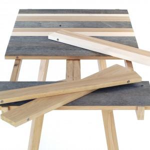 Hansenowski stół to - jak sugeruje nazwa - projekty zainspirowany twórczością Oskara Hansena. Blat komponowany jest z wymiennych desek, mocowanych na magnesach, co pozwala dobierać różne gatunki i kolory drewna: stare, wypłowiałe z nowym, nie dotkniętym upływem czasu. Fot. Malafor.