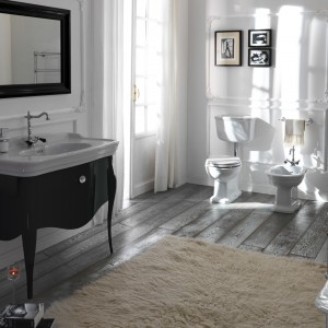 Ceramika łazienkowa z serii Impero dobrze prezentuje się w połączeniu ze stylizowanymi meblami. Fot. Olympia.