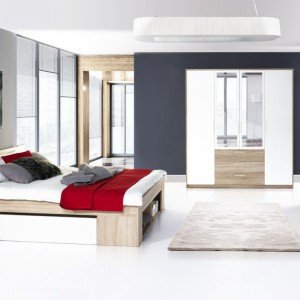Sypialnia Milo marki Marmex w modnym połączeniu rysunku drewna z lakierowaną bielą. Zestaw tworzą: łóżko, 2 stoliki nocne, komoda oraz szafa z lustrem. Fot. Marmex.