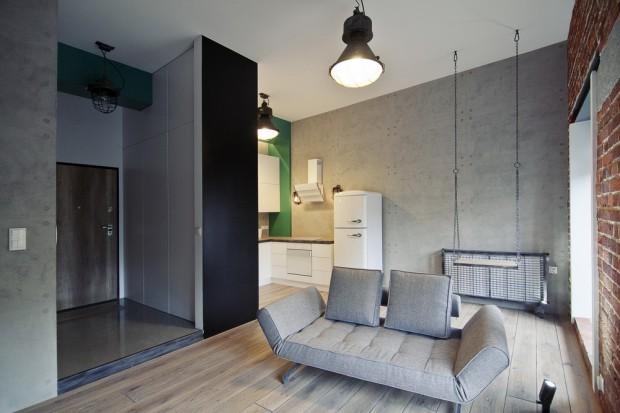 Czerwona cegła, dekoracyjny beton oraz industrialne lampy, pochodzące z poprzemysłowych budynków. Tak wygląda mieszkanie w stylu loft we Wrocławiu.
