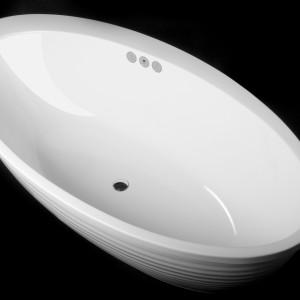 Wnętrze wanny Boomerang firmy Vayer ma powłokę antybakteryjną. W tym modelu zastosowano także system podgrzewania wody Etna. Dzięki unikalnej instalacji przewodów rozprowadzających ciepło w obrębie wanny, może ona jednocześnie służyć jako grzejnik łazienkowy. Fot. Vayer.