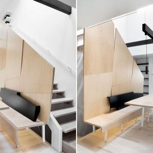 Stół jadalniany, ławę, połączoną z zabudową ze sklejki drewnianej, a także wyspę w kuchni wsparto na białych nogach wykonanych z metalowych tub. Projekt: Nature Humaine. Fot. Adrien Williams.