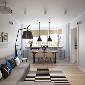 Szara kanapa harmonizuje ze stylem lamp, mimo różnych faktur. Elementem, który ożywi każde wnętrze są kolorowe poduszki, które kontrastują wśród klasycznych odcieni bieli i czerni. Projekt i wizualizacje: Alexei Ivanov i Pavel Gerasimov / Studio projektowe Geometrium.