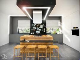 Symetryczny układ kuchni z umiejscowioną centralnie drewnianą wyspą.