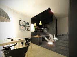 Wiszące półki oraz drewniany blat ocieplają wnętrze ciemnej kuchni.