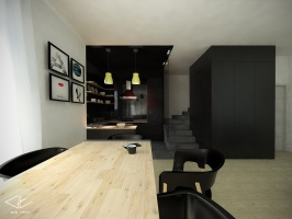 Ciemna wnęka kuchenna koresponduje z ciemną zabudową stolarską.
