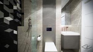 Minimalistyczna szara łazienka.
