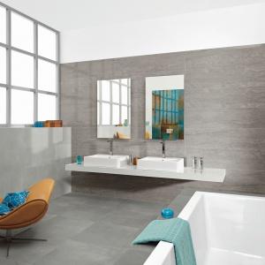 Płytki gresowe szkliwione o matowej powierzchni dobrze sprawdzą się w łazience w stylu loft. Duże formaty znacznie ułatwiają układanie w łazience. Na zdjęciu: kolekcja Daino Reale marki My Way. Fot. My Way.