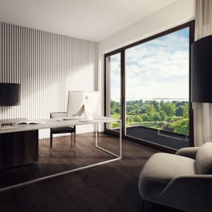 W mieszkaniu znalazło się również miejsce na gustownie urządzony gabinet. W dobrze doświetlonym pomieszczeniu łatwo się skupić i pracować. Projekt: Tamizoo Architects. Fot. Echo Investment.