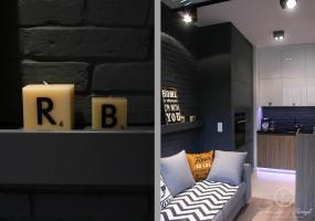 Dobrze dobrane dodatki współgrają z ceglaną ścianą i sprawiają że wnętrze jest mniej surowe.